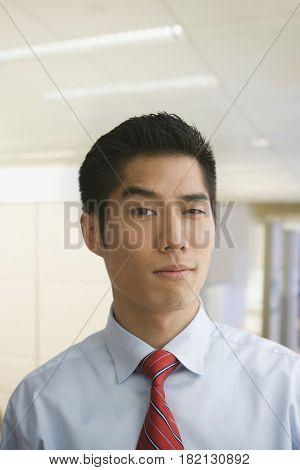 Korean businessman raising eyebrow