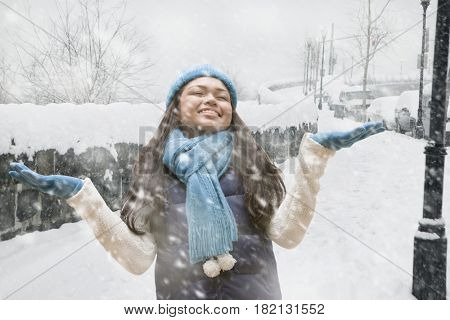 Hispanic girl standing in snow