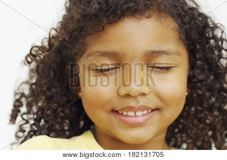 Close up of mixed race girl with eyes closed