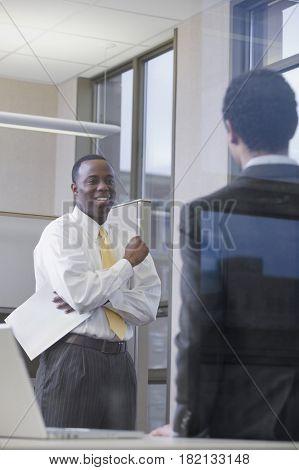 Multi-ethnic businessmen meeting in office