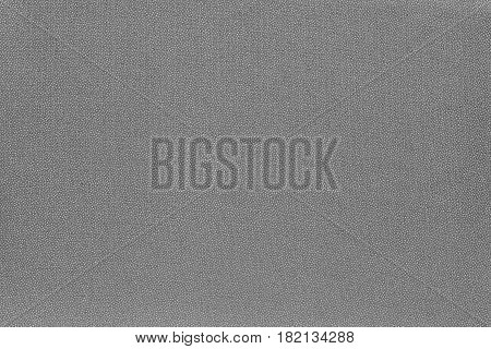 abstract speckled texture and background of textile material or fabric of gray color