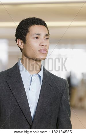 Mixed race businessman looking pensive