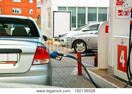 gasoline pump refueling. car at the petrol gas station