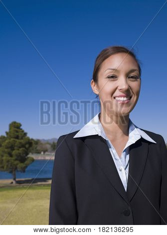 Mixed race businesswoman outdoors smiling