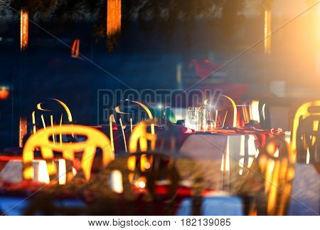 resort's restaurant is the setting sun, evening, reflections on the wine glasses