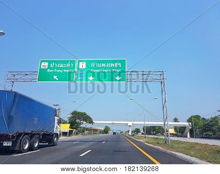 KAMPHAENG PHET THAILAND - MARCH 31 : directional traffic sign to Kamphaeng Phet and Ban Pang Makha on March 31 2017 in Kamphaeng Phet Thailand.