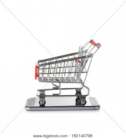 Online shopping concept. Smartphone with mini market trolley on white background