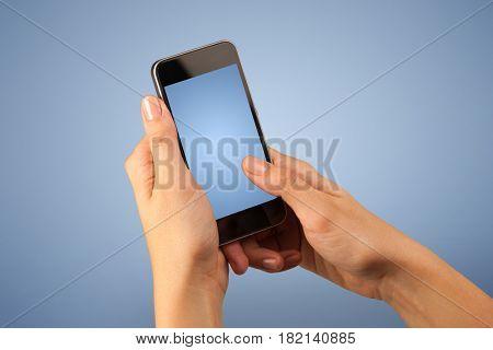 Female fingers touching blank smartphone