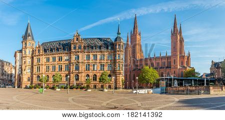 WIESBADEN, GERMANY - APRIL 10,2017 - Panoramic view at the Markt place with City hall and Markt church in Wiesbaden. Wiesbaden is one of the oldest spa towns in Europe.