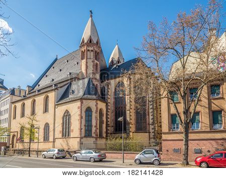 FRANKFURT AM MAIN ,GERMANY - MARCH 30,2017 - St.Leonhard church in the streets of Franfurt am Main. Frankfurt is the major financial centre of the European continent.