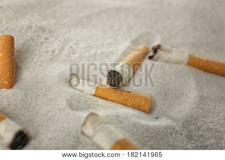 Cigarette butts on sand