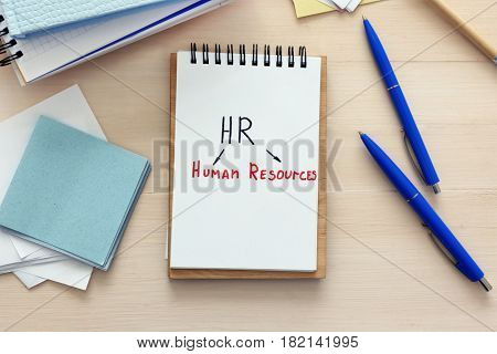 Notebook with written text HUMAN RESOURCES on wooden table