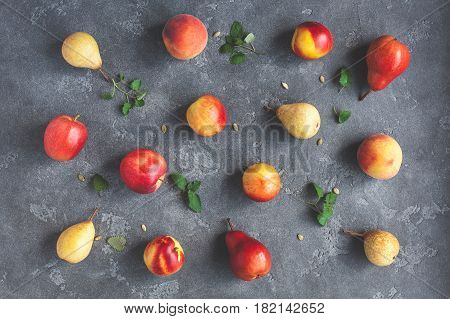 Fruits on black background. Pears apples peaches nectarines. Fruit pattern. Flat lay top view