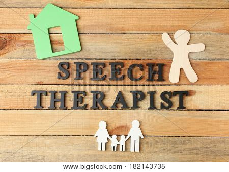 Inscription SPEECH THERAPIST made with  letters on wooden background