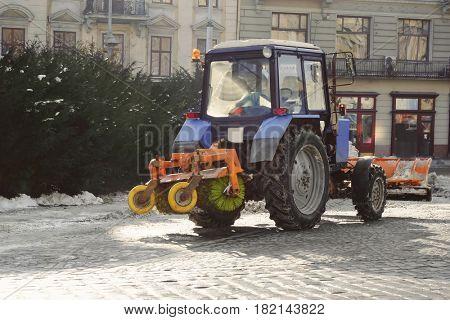 Snow plow at work on city street