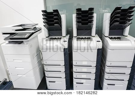 four printer machines in office ready for business documents