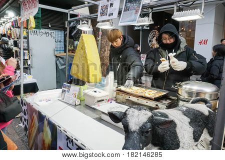 merchant of fried cheese street food taken in Seoul South Korea on 14 February 2017