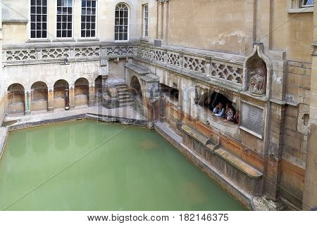 BATH, GREAT BRITAIN - MAY 14, 2014: Roman baths are a historical complex in which the houses above them were built in the XIX century.