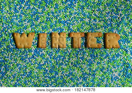 Winter. The Word From The Edible Letters Lies On The Glazed Powder