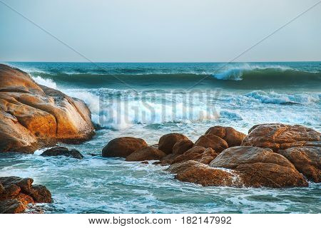 Magnificent seascape. Waves of the Indian Ocean are broken against stones.
