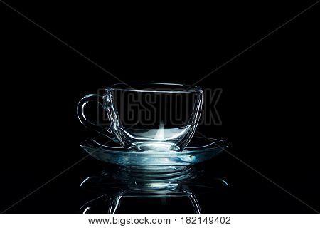 Clean glassware on a black background, studio light