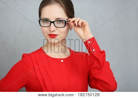 Fashion Business Woman With A Red Shirt And Glasses Portrait, Holding Sunglasses In His Hand