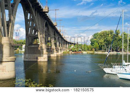 Landscape with railroad arched bridge in Dnepropetrovsk Ukraine at fall season.