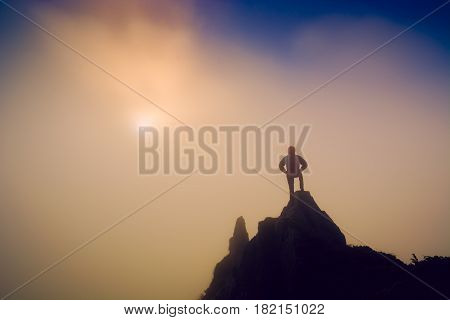 Silhouette Of Hiker On A Cliffs Edge