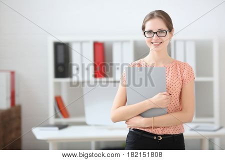 Business Woman Holding A Writing Tablet In The Office
