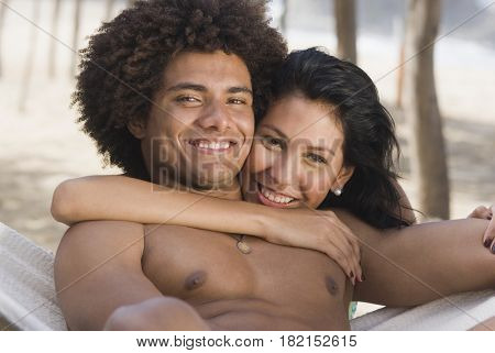 Multi-ethnic couple laying in hammock