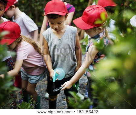 Group of children watering organic fresh agricultural product