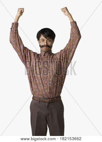 Angry Indian man with arms raised