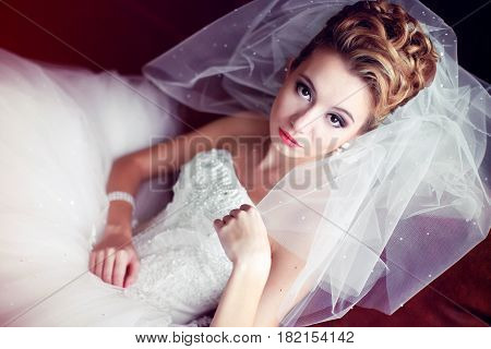 Bride Looks In A Provoking Manner Sitting In The Big Chair
