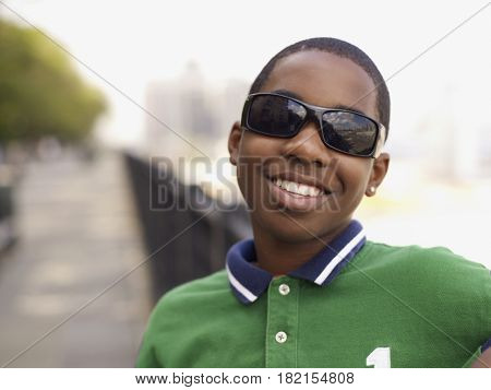 African teenage boy in sunglasses smiling