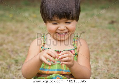 Smiling Mixed race girl playing