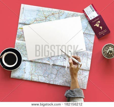 Hand holding toy airplane and planning travel destination
