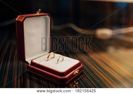 Wedding rings of the newlyweds in a box. Engagement gold rings. Wedding in Montenegro.