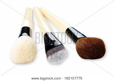 Cosmetics and beauty. Make-up brushes set in row on white isolated background. Selective focus, shallow depth of field