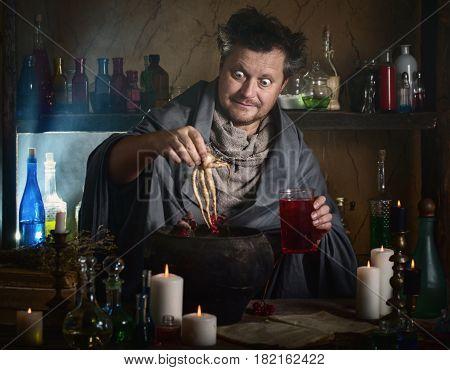 the crazy wizard brews a potion indoor