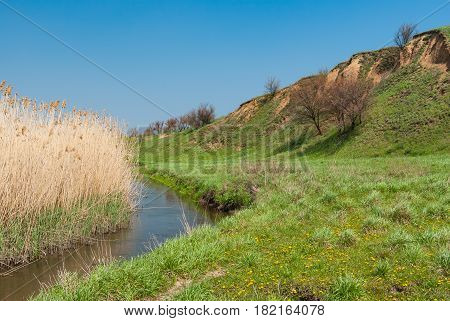 Spring landscape with small Ukrainian river Sura .