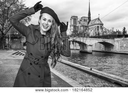 Smiling Woman On Embankment In Paris, France Having Fun Time