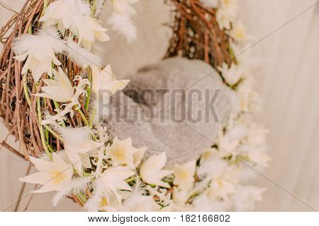 In the room of the balance a woven floral wreath of white tulips and feathers