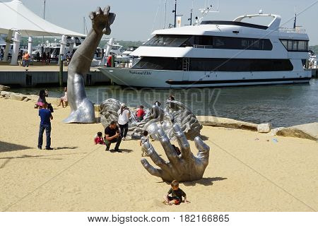 WASHINGTON, DC - APR 16: The Awakening at National Harbor in Maryland, as seen on April 16, 2017. It is a 72-foot (22 m) statue of a giant embedded in the earth, struggling to free himself.