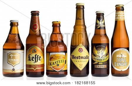 GRONINGEN, NETHERLANDS - APRIL 15, 2017: Collection of Chimay, Leffe, Kasteel, Westmalle, Grimbergen and Anvers tripel beers isolated on a white background