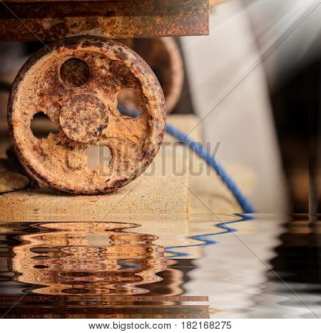 Old Rusty Slide Door With Wheel And Reflection