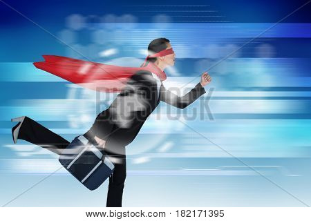 Businesswoman running while pretending to be super hero against abstract technology background