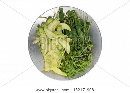 Boiled coccinia grandis and sesbania grandiflora vegetables on stainless steel plate isolated on white background