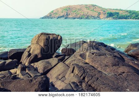 Seascape With A Stony Shore And A Mountain