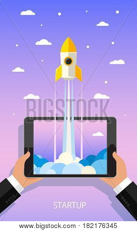 Concept of Start up. Businessman holding a tablet with a rocket. Flat design, vector illustration.