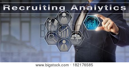 Blue chip recruitment agent arranging a virtual measurement tool icon in a Recruiting Analytics application. Business concept for recruiting campaign insights gained via analytical software.